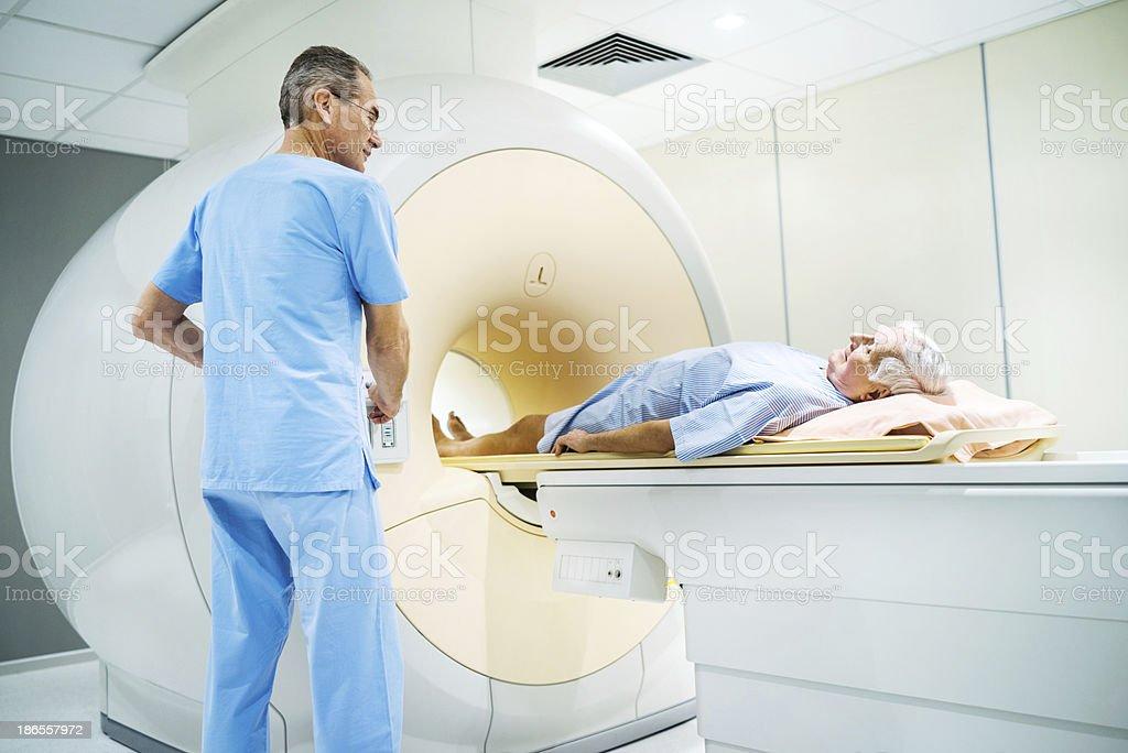 Senior receiving an MRI Scan. stock photo