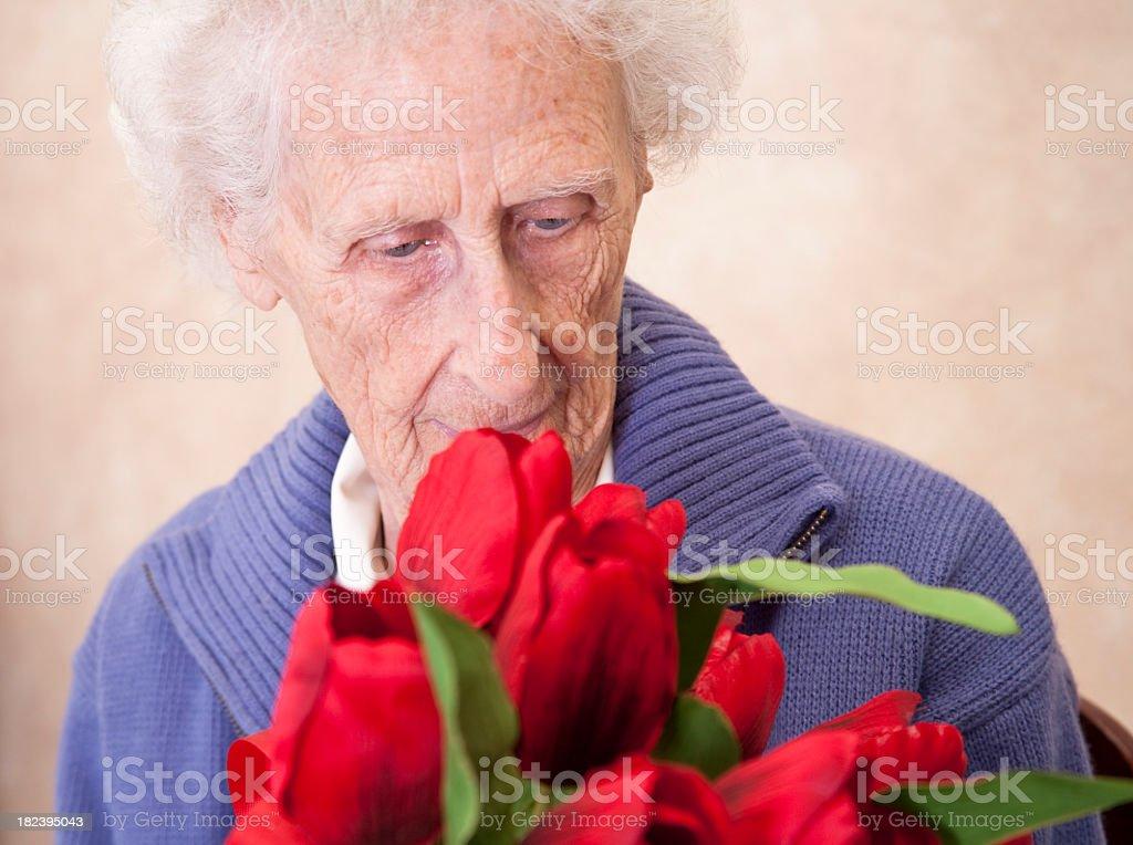 Senior receiving flowers royalty-free stock photo