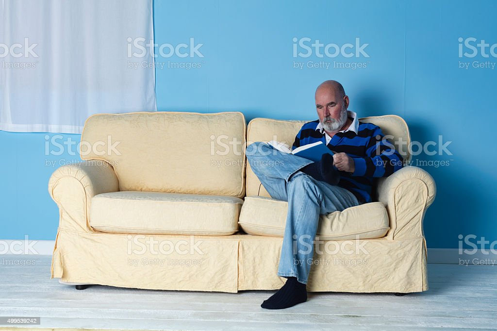 Senior Relaxing With A Book stock photo