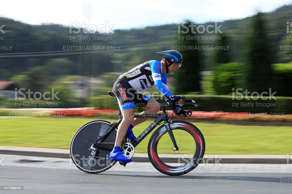 Senior riding a bicycle royalty-free stock photo