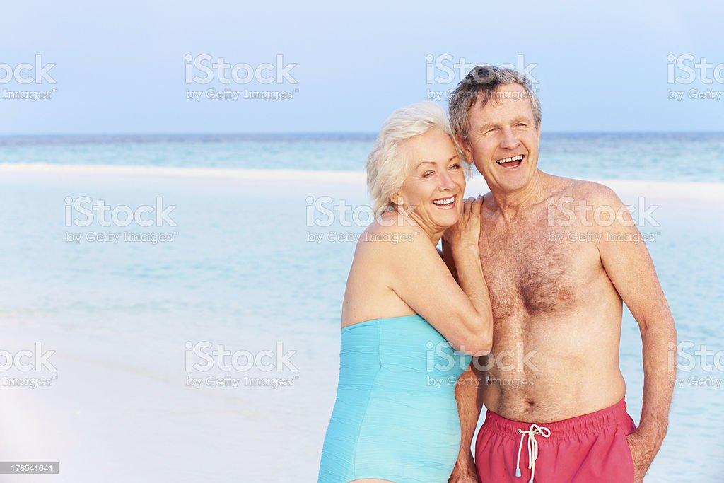 Senior Romantic Couple Walking In Beautiful Tropical Sea royalty-free stock photo