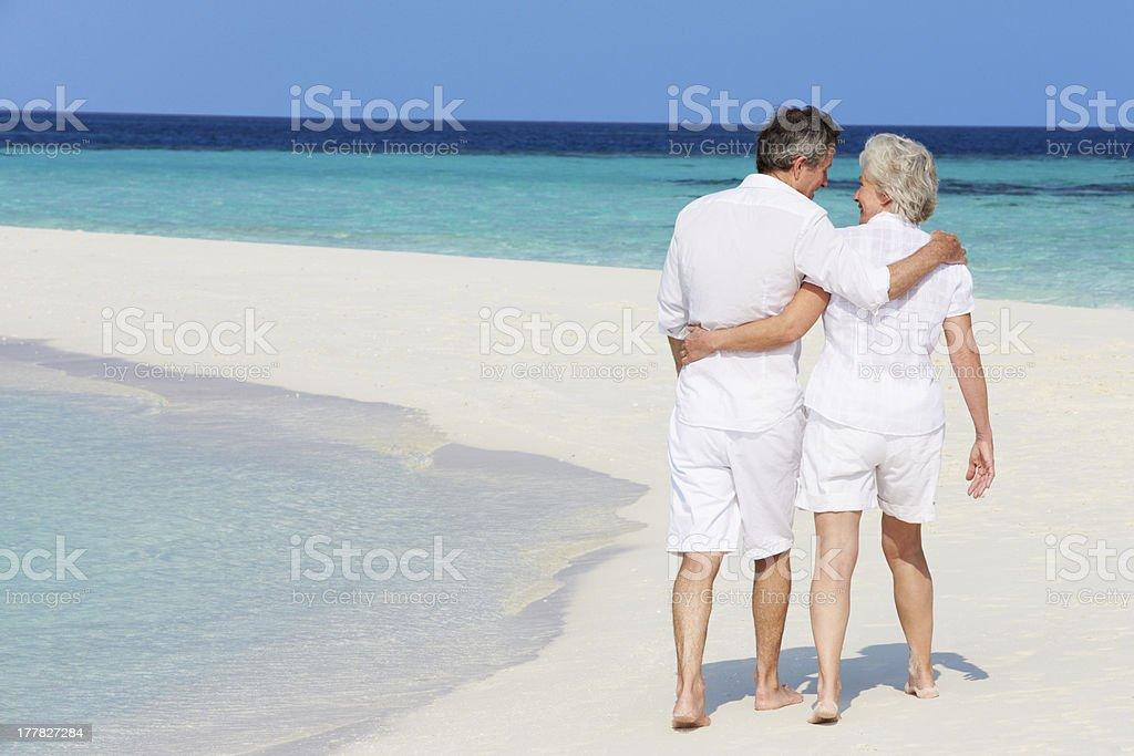 Senior Romantic Couple Walking On Beautiful Tropical Beach royalty-free stock photo