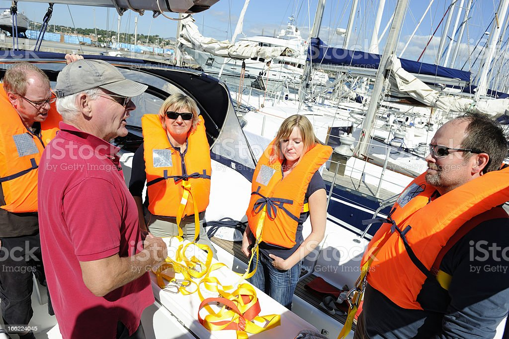 Senior Sailing Instructor Giving Safety Briefing royalty-free stock photo
