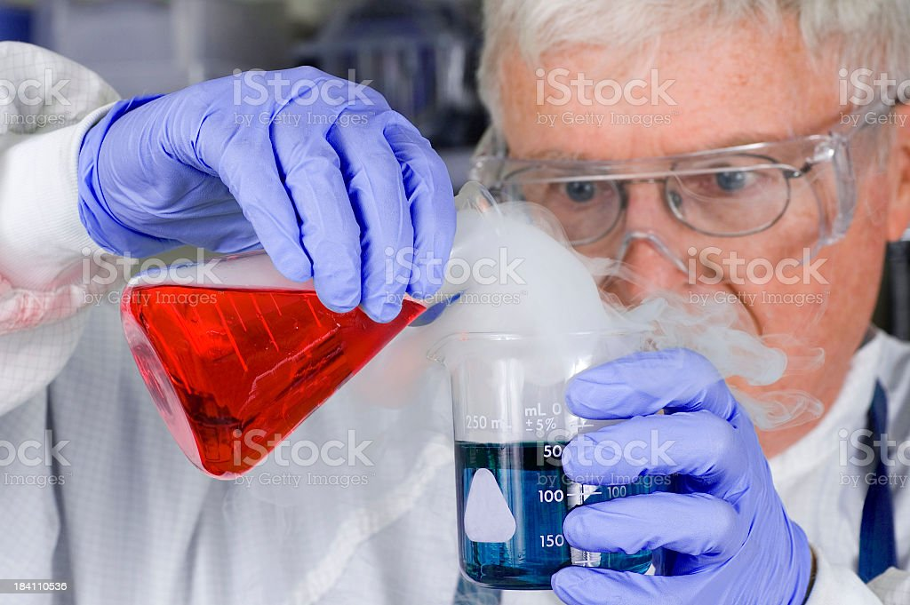 Senior Scientist Chemist With Steaming Chemicals royalty-free stock photo