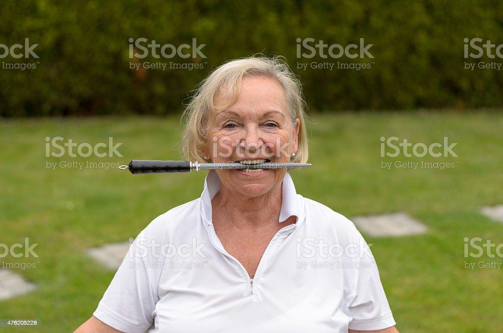 Senior serene woman biting on a file stock photo