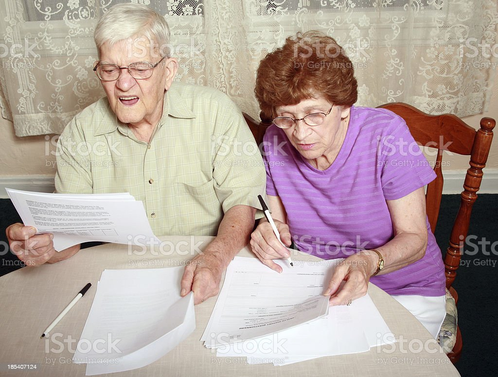 Senior Series: Confusing Medical Forms royalty-free stock photo