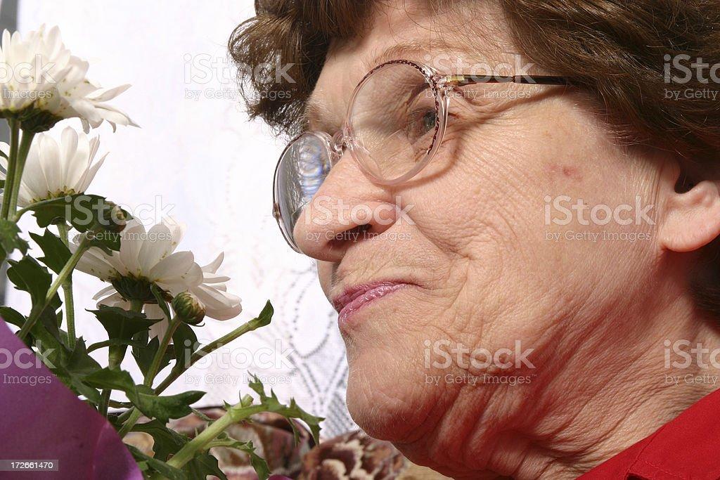 Senior Series: Smelling Flowers royalty-free stock photo