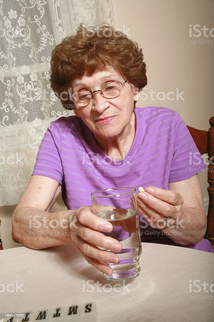 Senior Series: Taking Pills royalty-free stock photo