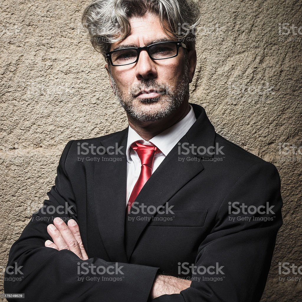 Senior serious business man with arm crossed royalty-free stock photo
