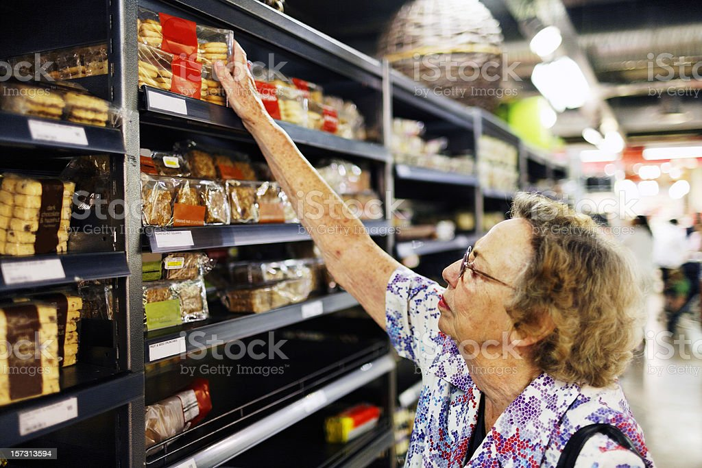 Senior shopping in supermarket royalty-free stock photo