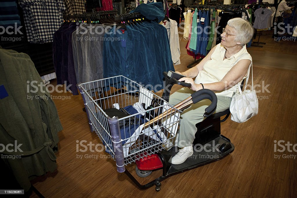 Senior shopping motorized wheelchair electric buggy cart royalty-free stock photo