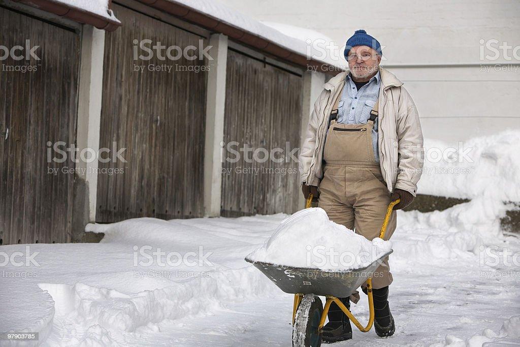 Senior Shovelling Snow royalty-free stock photo
