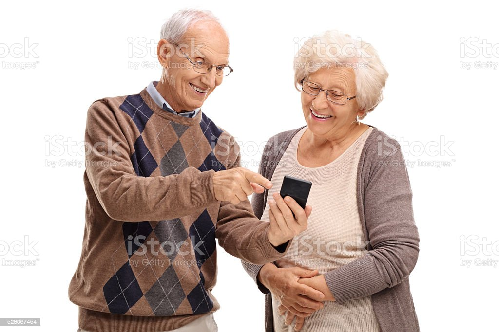 Senior showing something to his wife stock photo