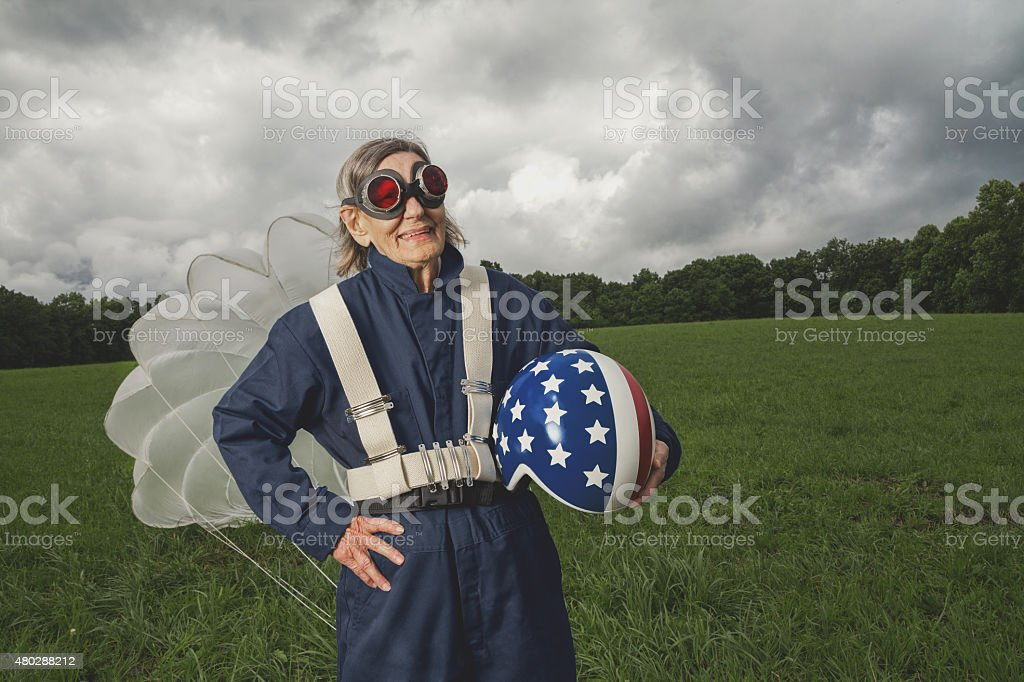 senior skydiver with helmet and parachute stock photo