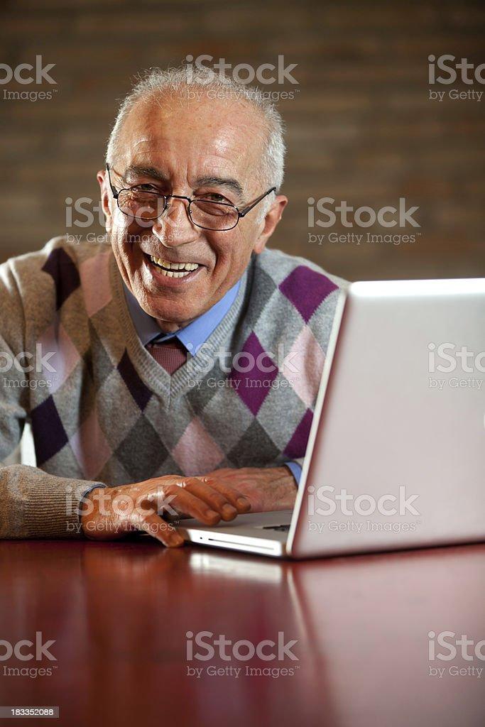 Senior smiling and laptop stock photo