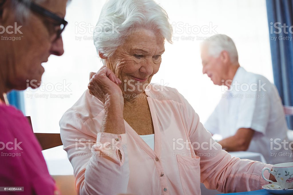Senior smiling woman with a cup of coffee stock photo