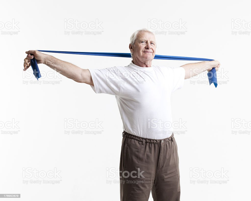 senior stretching with a rubber band stock photo