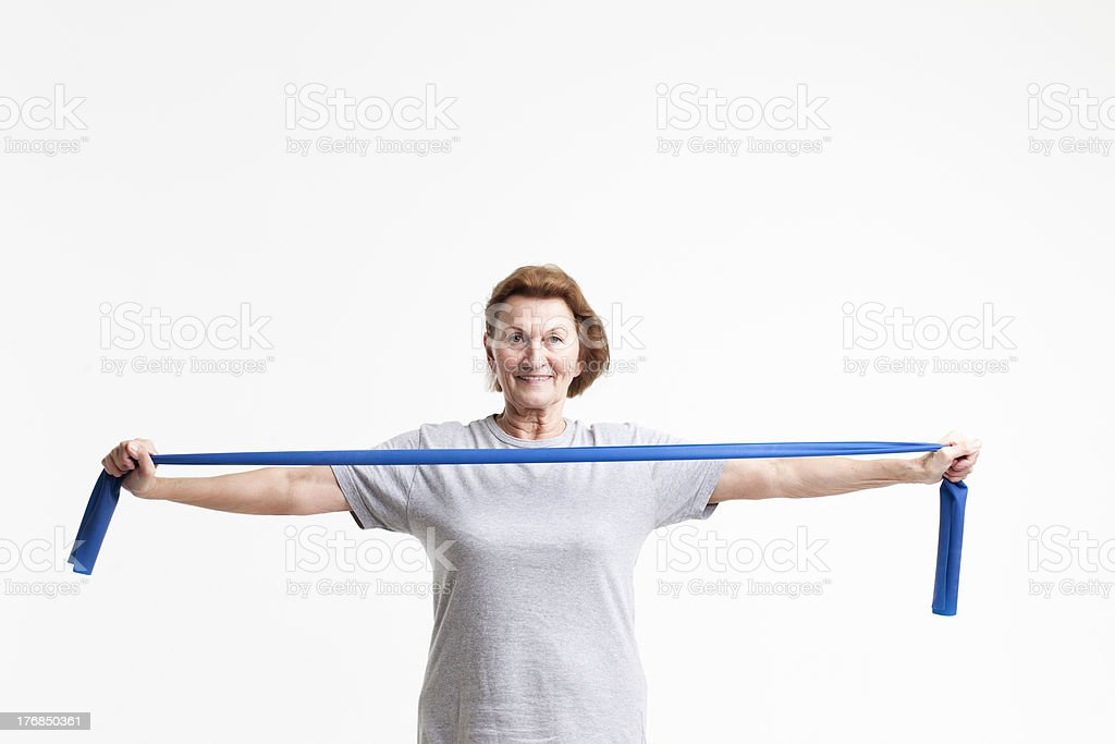 senior stretching with a rubberband stock photo