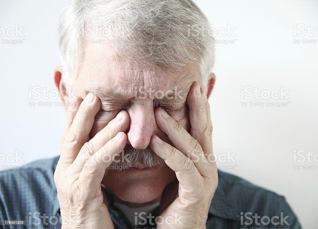 senior suffering from sinus pressure stock photo