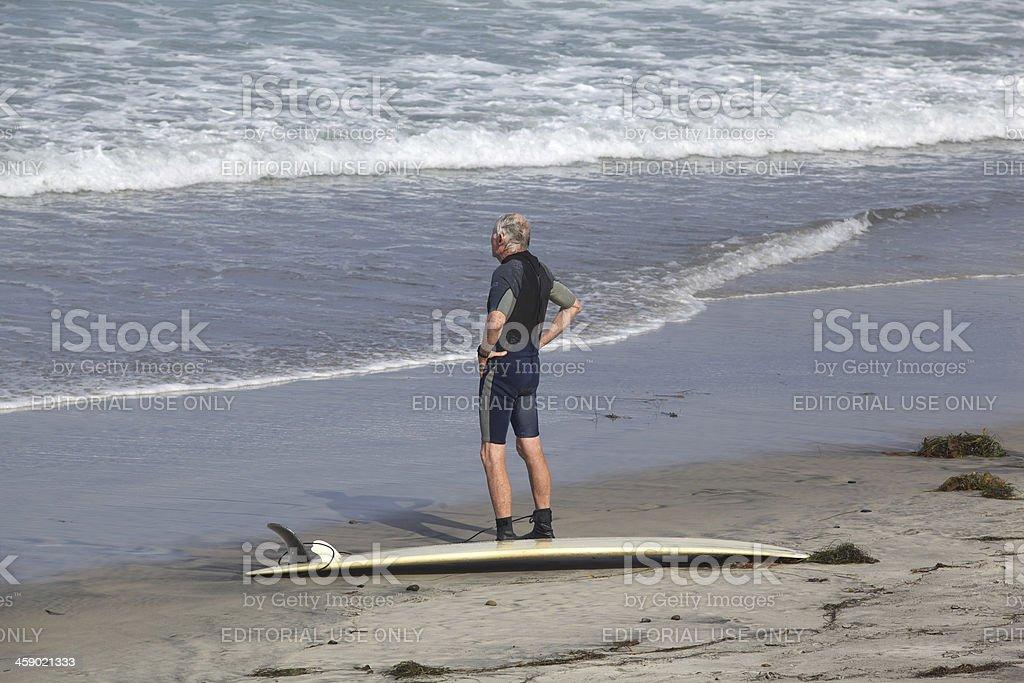 Senior Surfer at Torrey Pines Beach in San Diego, California stock photo