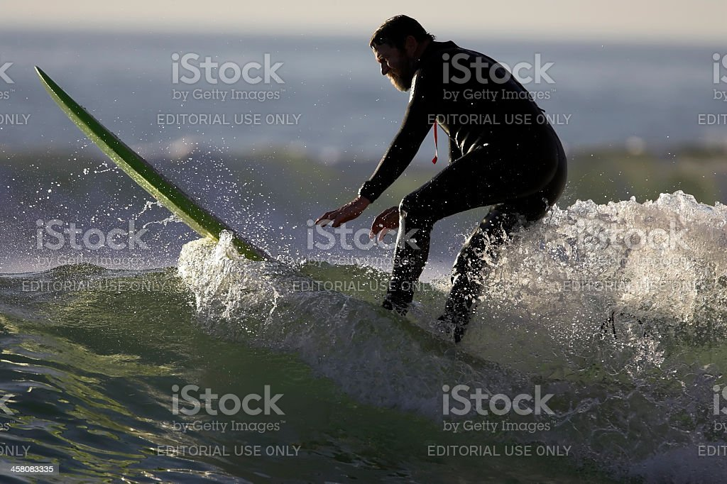 Senior Surfer Exits a Wave stock photo