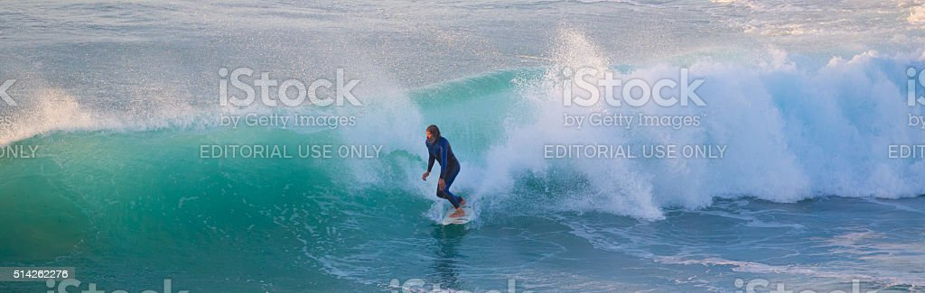 Senior surfer riding a perfect wave. stock photo
