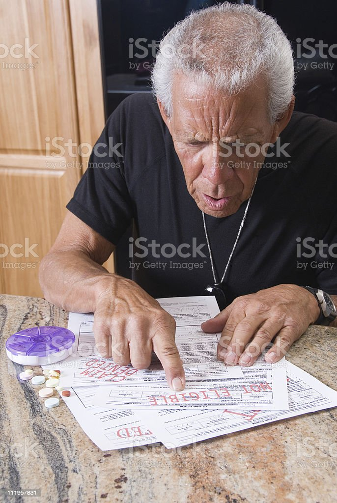 Senior surprised with his denied medical bills stock photo