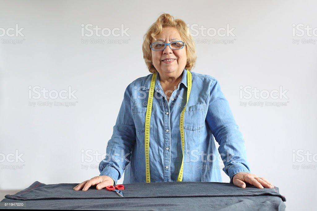 Senior tailor woman authentic portrait stock photo