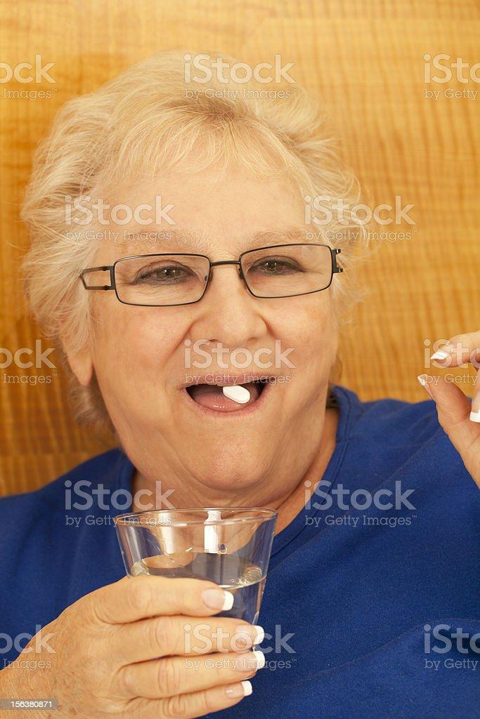 senior taking medication royalty-free stock photo