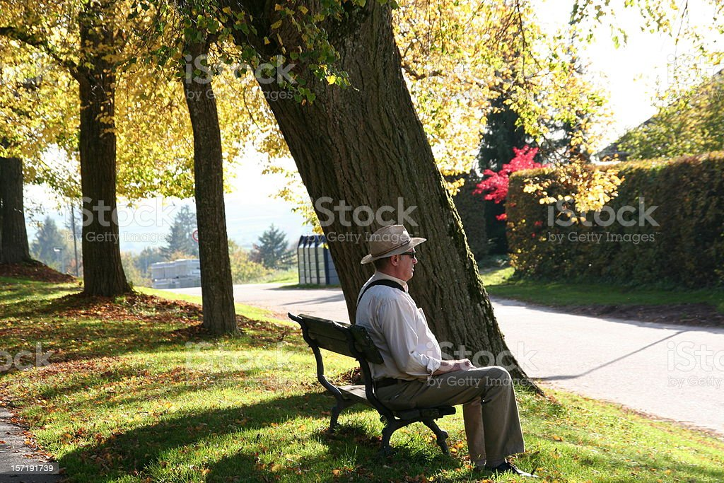 senior taking rest on a bench royalty-free stock photo