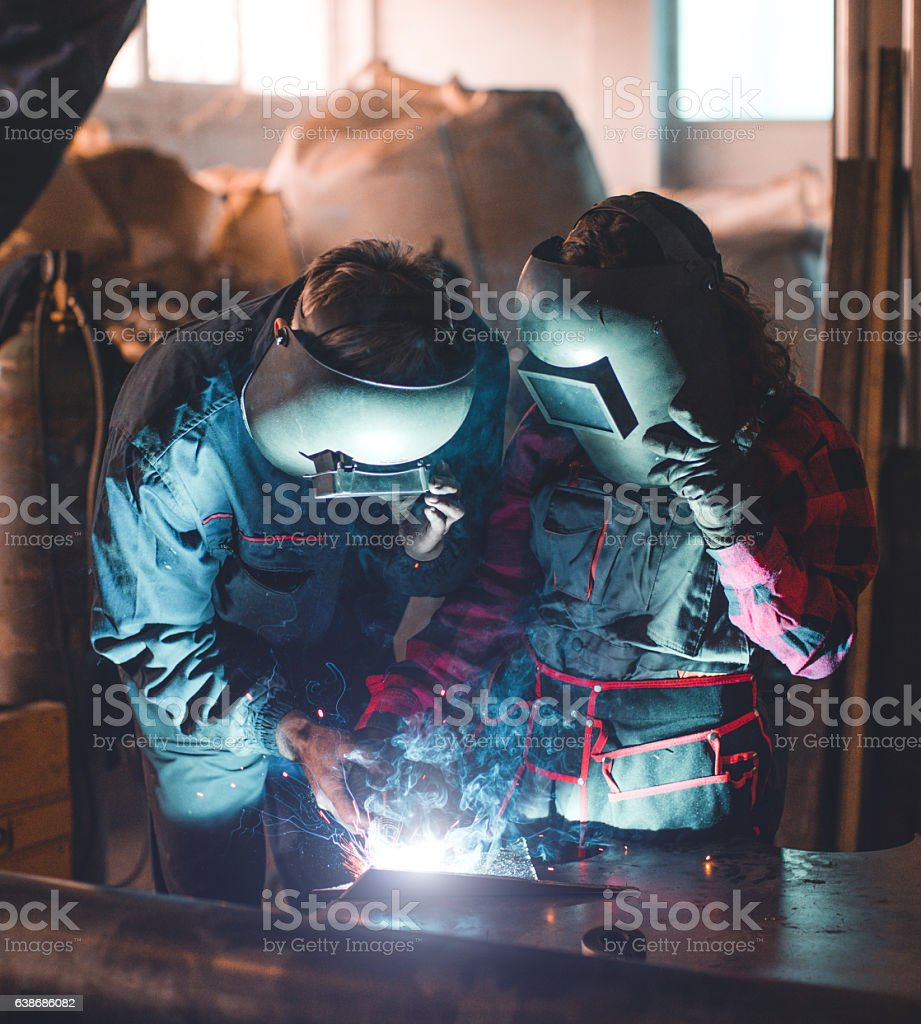 Senior teacher and young woman worker... stock photo