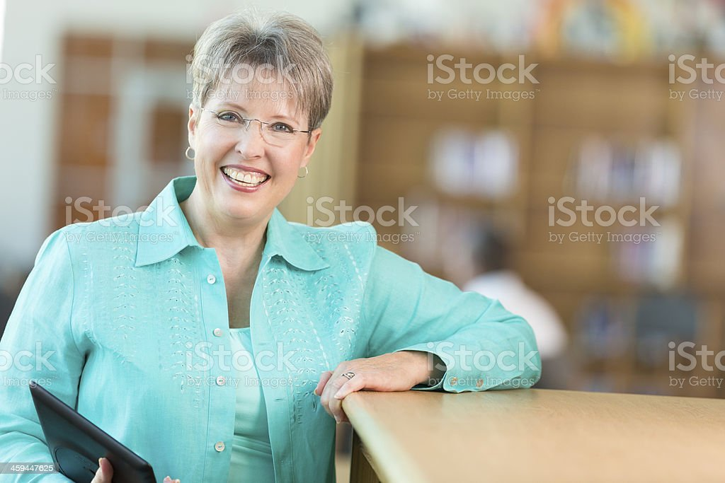 Senior teacher in high school library after class royalty-free stock photo
