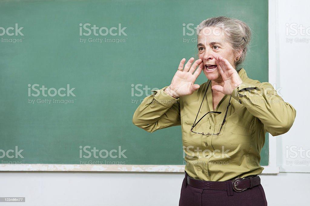 Senior teacher yelling at class royalty-free stock photo