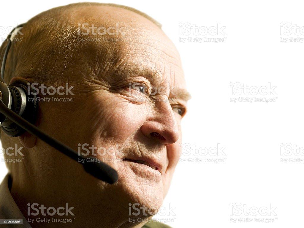 Senior telemarketing employee royalty-free stock photo