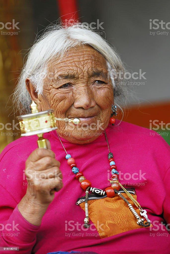 Senior Tibetan Prayer royalty-free stock photo