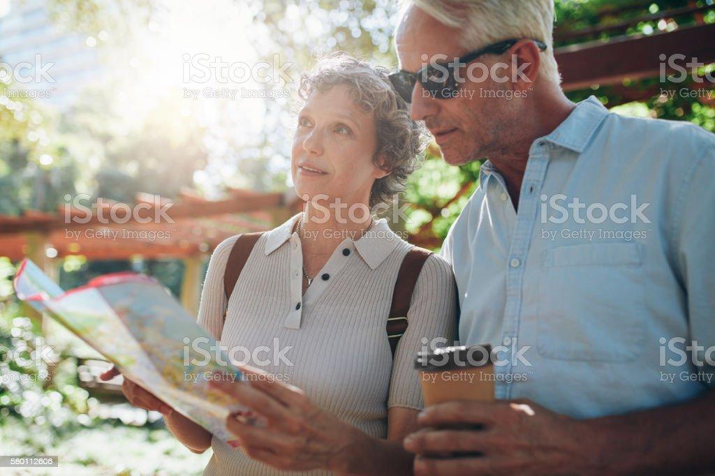 Senior tourist exploring new places to visit stock photo