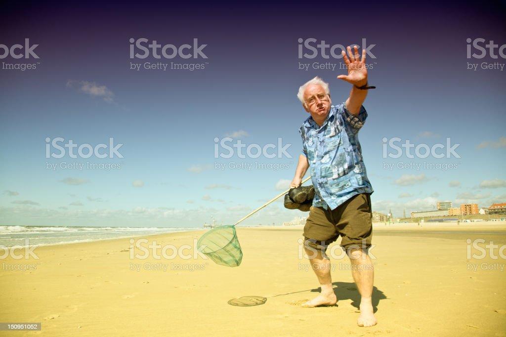 Senior tourist on the beach royalty-free stock photo