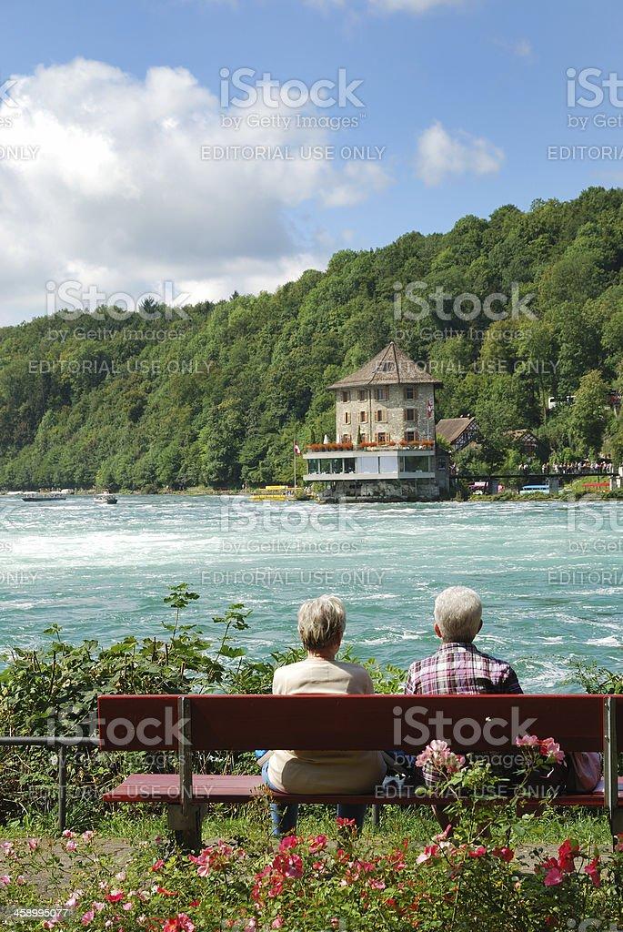 Senior tourists admiring Rheinfall. royalty-free stock photo