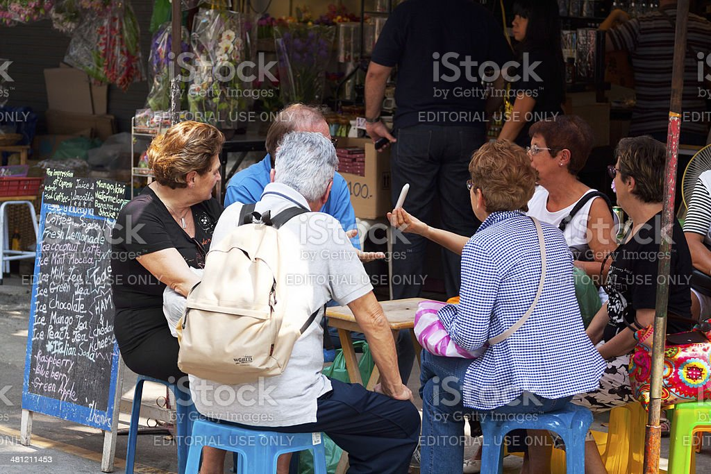 Senior tourists on Chatuchak Weekend market royalty-free stock photo