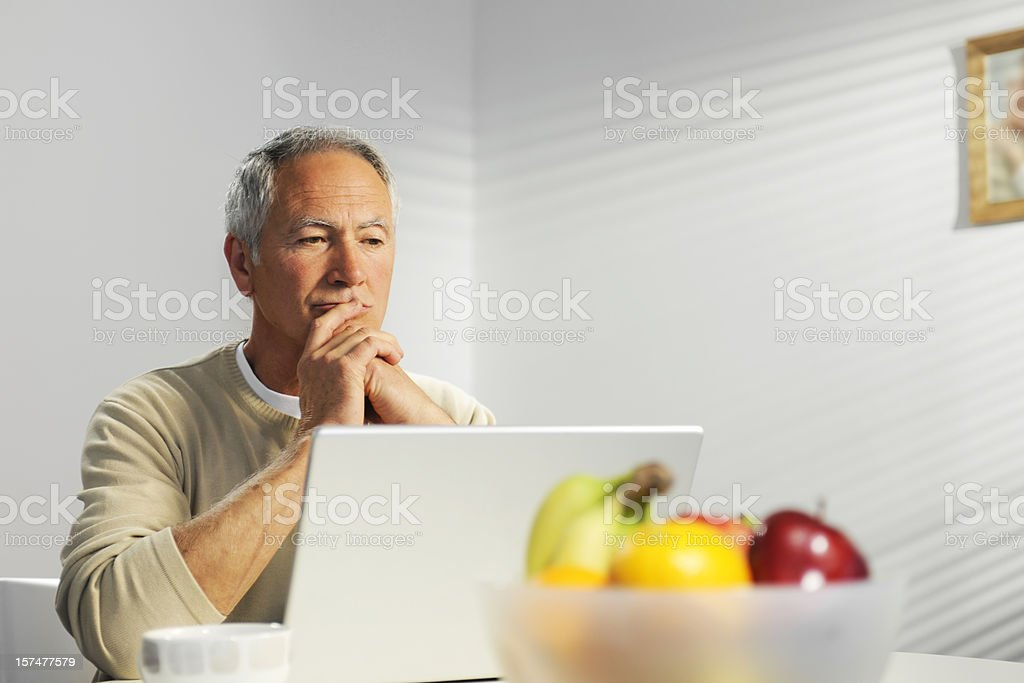 senior using laptop royalty-free stock photo