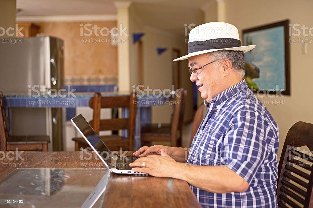 senior using laptop royalty-free stock photo