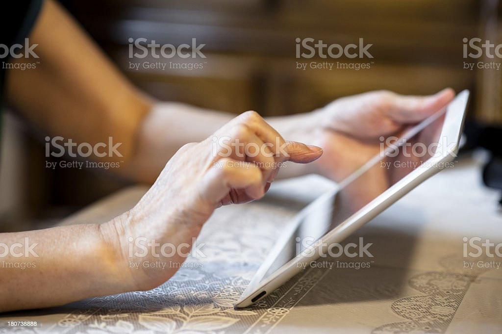 Senior using tablet computer royalty-free stock photo