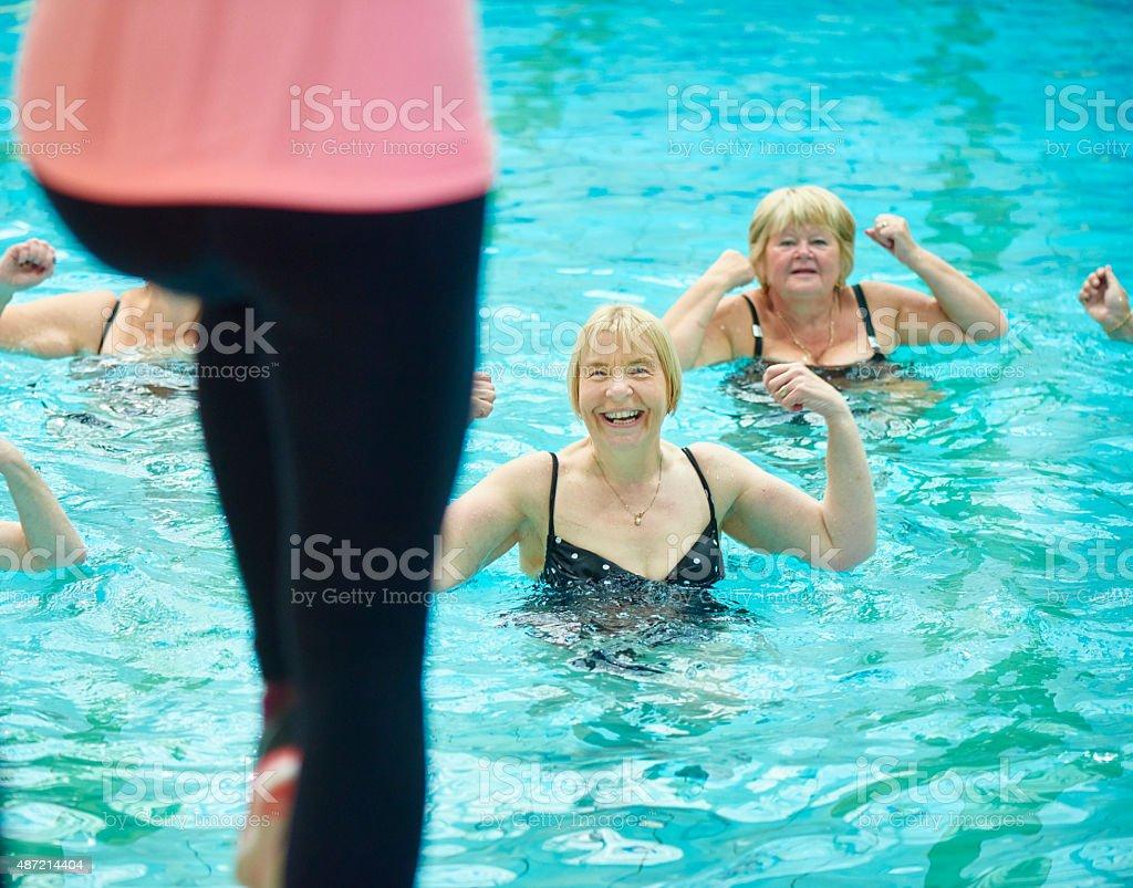 senior water aerobics stock photo