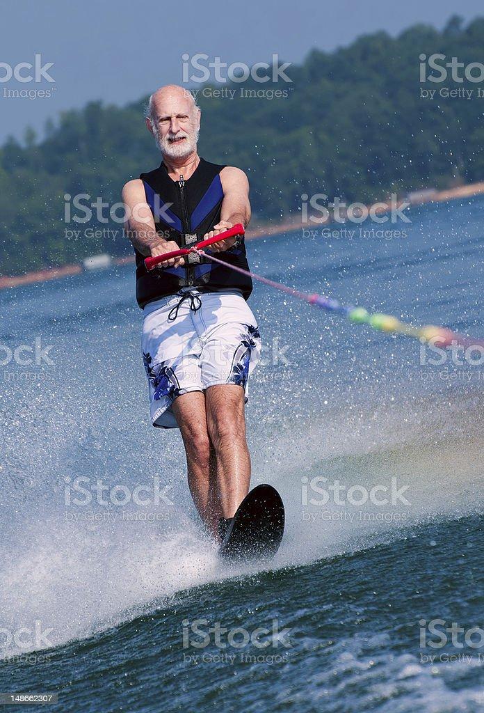 Senior waterskis royalty-free stock photo