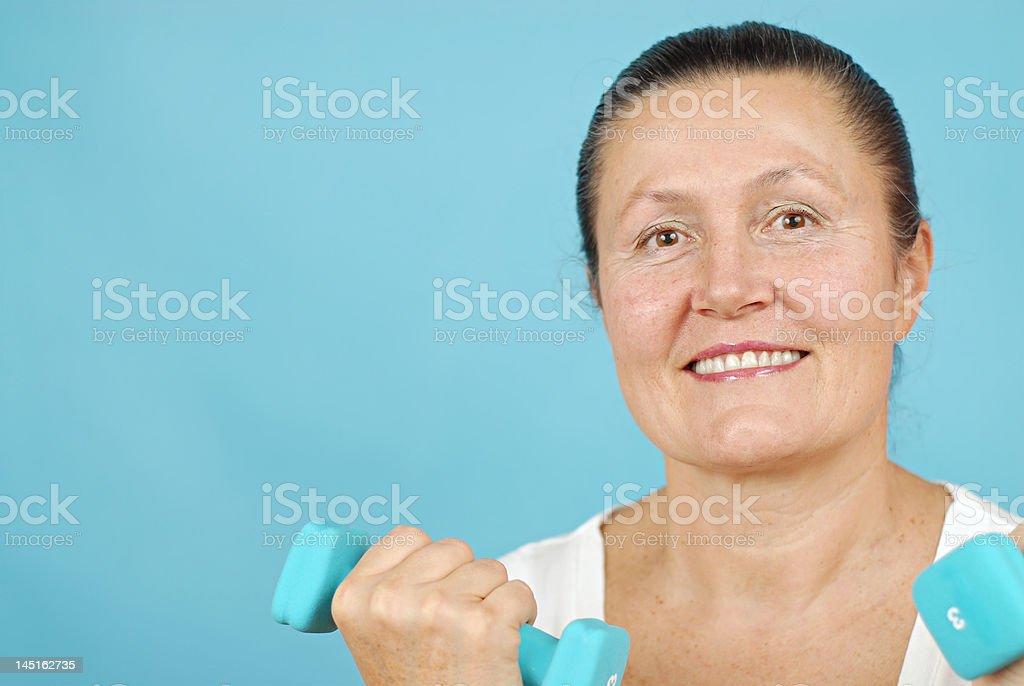 Senior weight lifting royalty-free stock photo