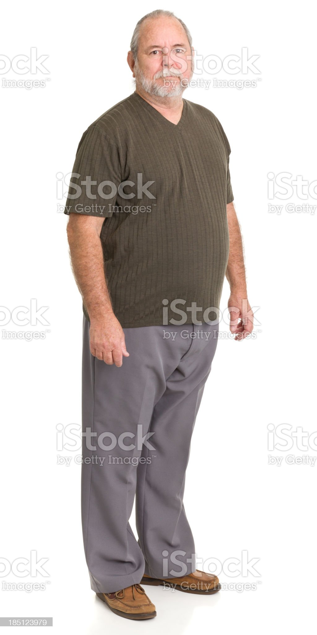 Senior white male in loafers, slacks, and a knitted shirt royalty-free stock photo