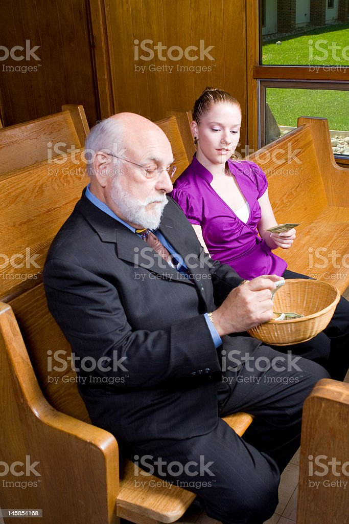 Senior White Man Young Woman Donating Money Church Offering Basket stock photo