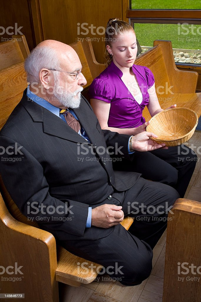 Senior White Man Young Woman Passing Empty Church Offering Basket stock photo