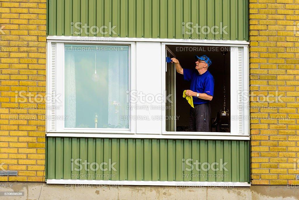 Senior window cleaner stock photo