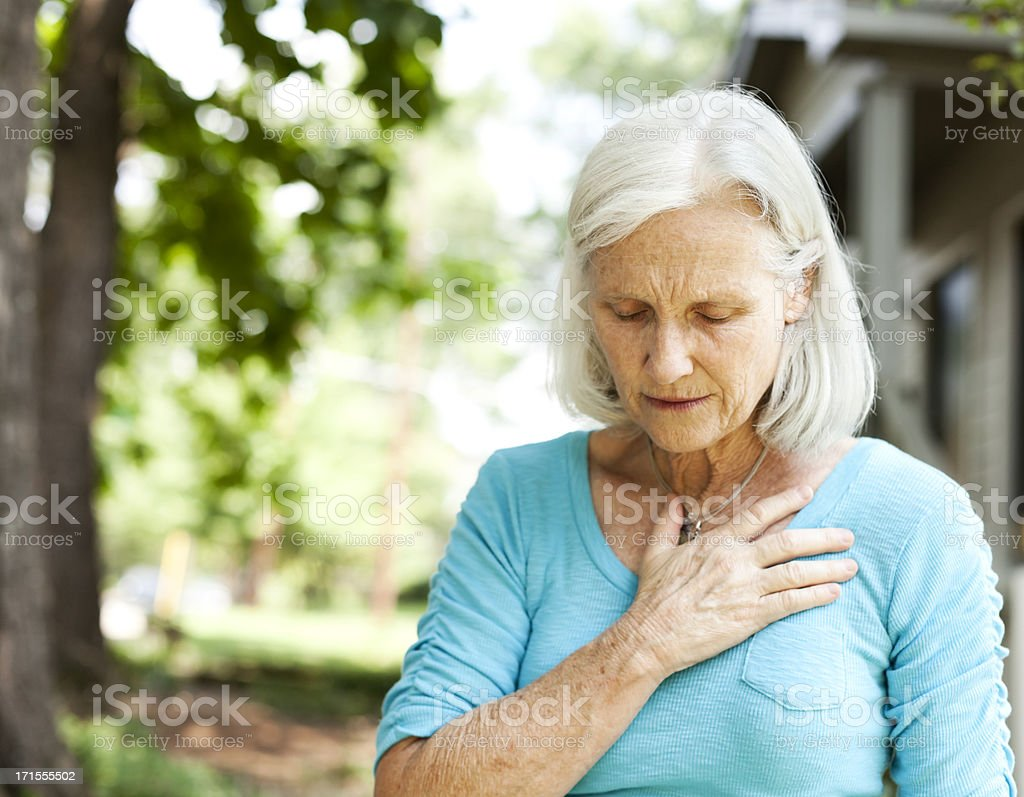 Senior with Chest Pain stock photo